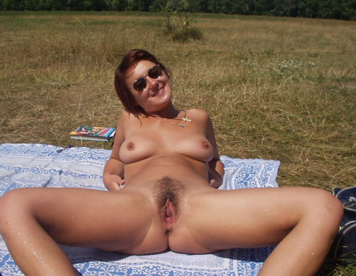 Sexy russian chick with sun glasses sun bathing naked out in the nature.jpg