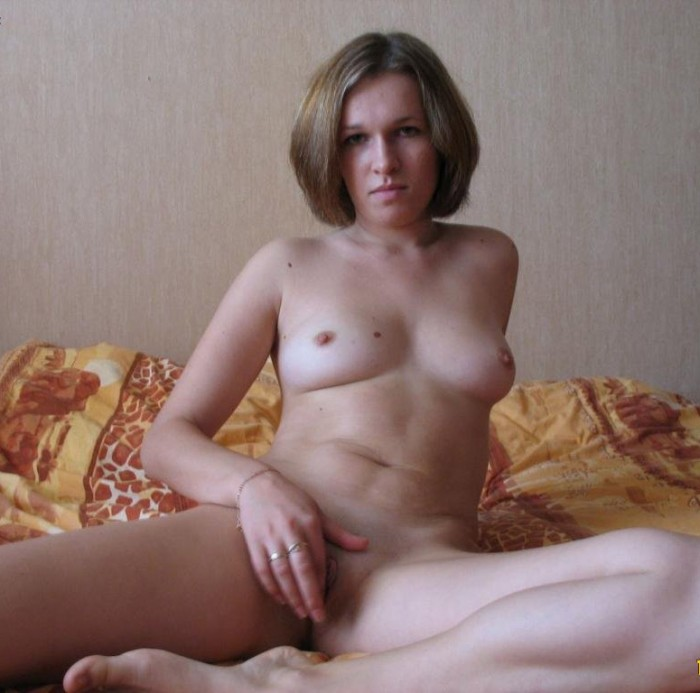 Smoking hot blond beauty with short hair is in business with fingering of her hot shaved pussy.jpg