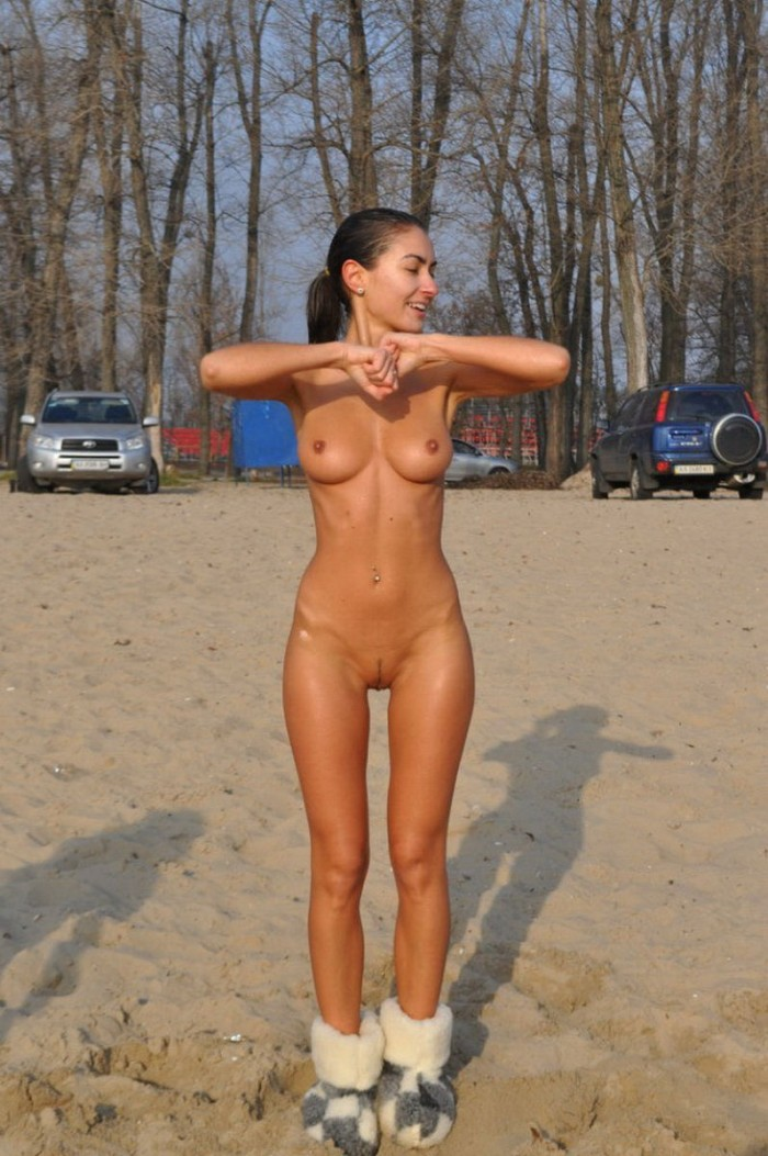 Amazing amateur girl with perfect sporty body and big boobs outdoors