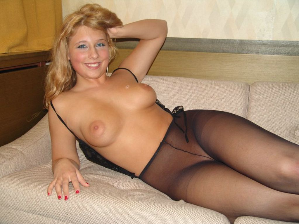 Busty brunette is wearing a seductive blouse, which shows her juicy tits