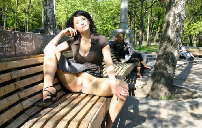 Hot Russian MILF spreads her legs in the park in shows her hairy cunt