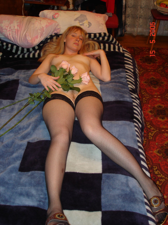 Amateur russian girl with very big boobs posing at home