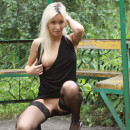 Beautiful blonde babe shows sweer shaved pussy at public