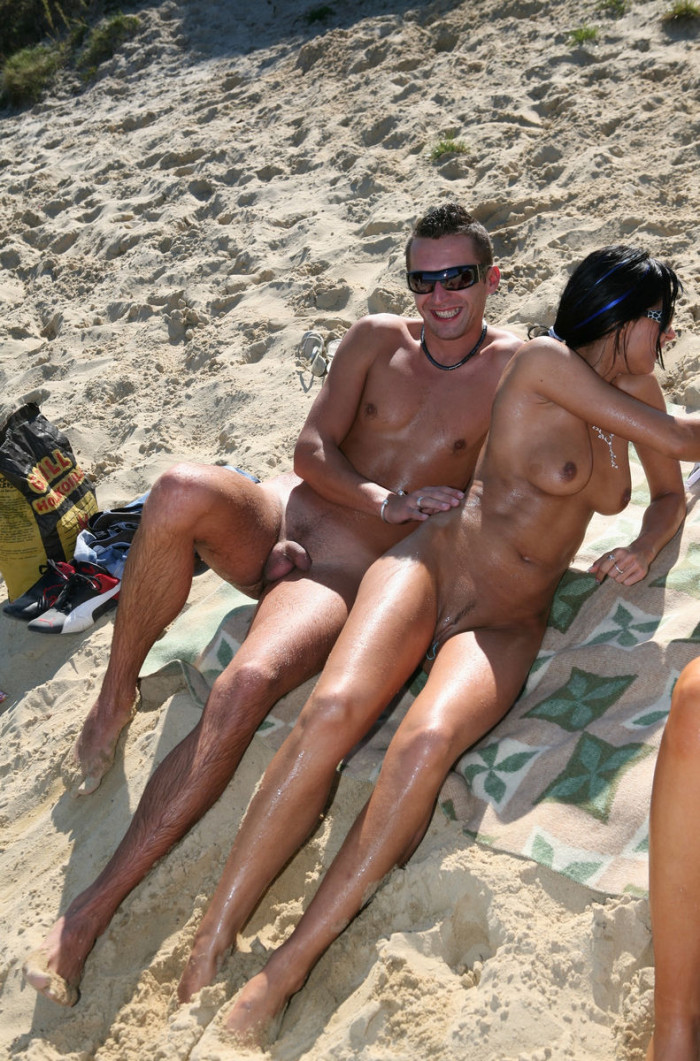 Group of young people have fun naked at beach