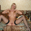 Nice russian blonde milf with big boobs shows shaved pussy at home