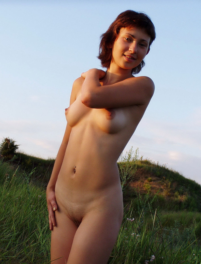 Lovely russian girl with tanlines on boobs posing at sunset beach