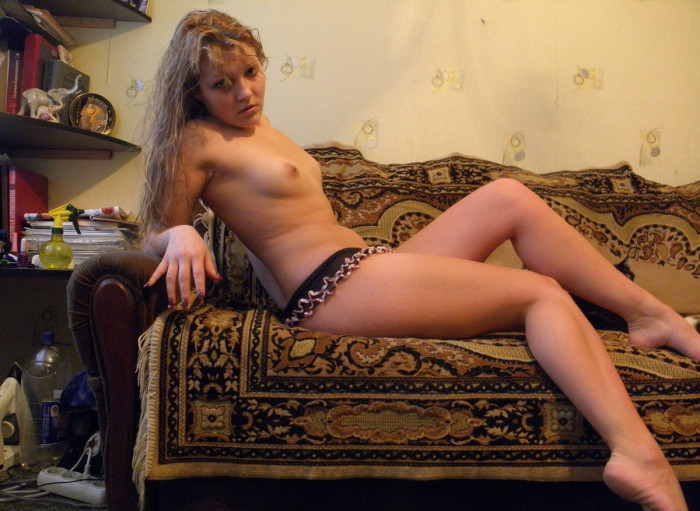 Curly russian girl with really big boobs shows her ideal naked body