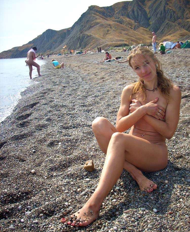 Teens strip nude on beach