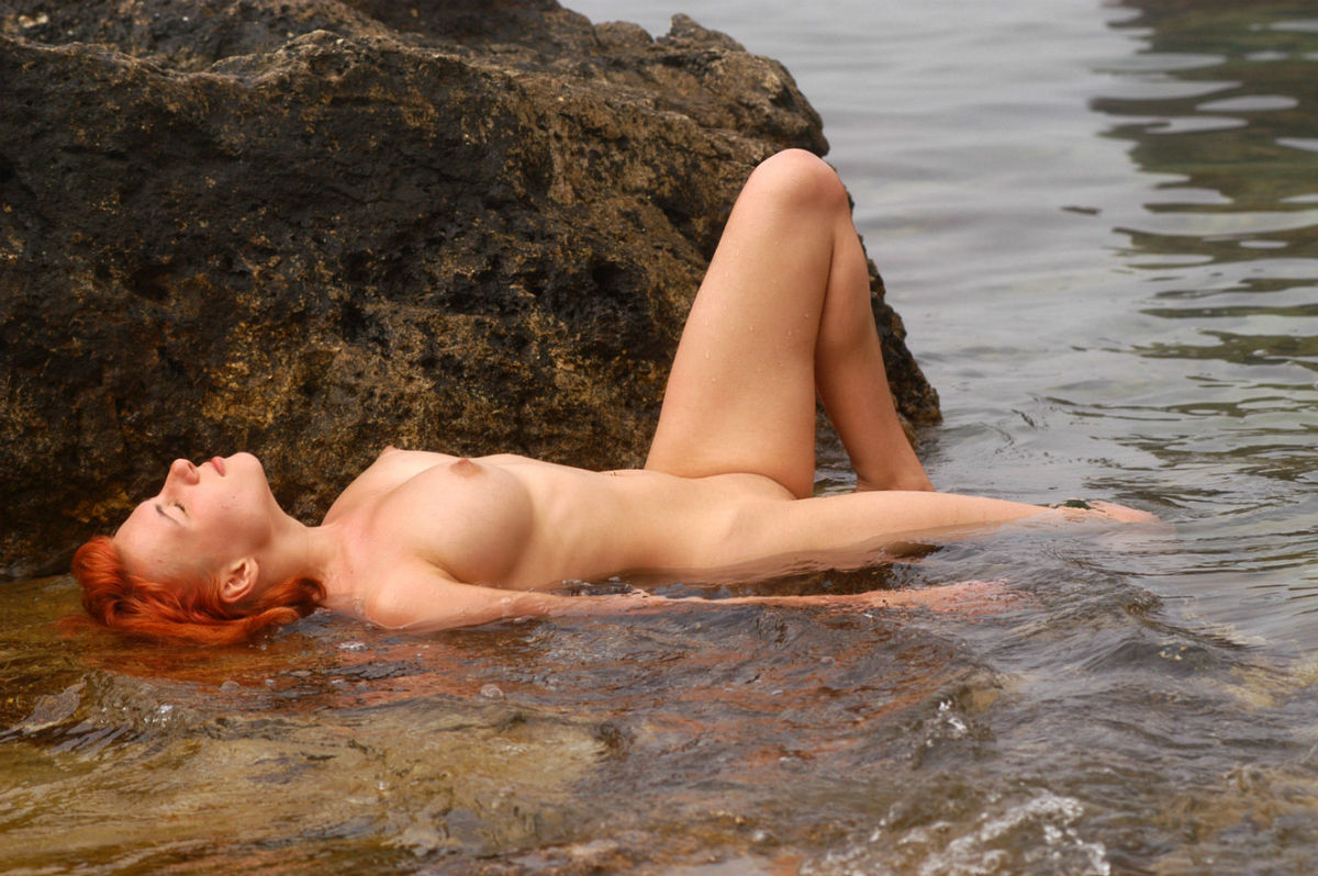 Busty redhead on the rocks   Russian Sexy Girls