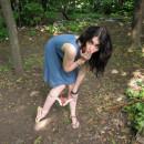 Naked brunette in forest