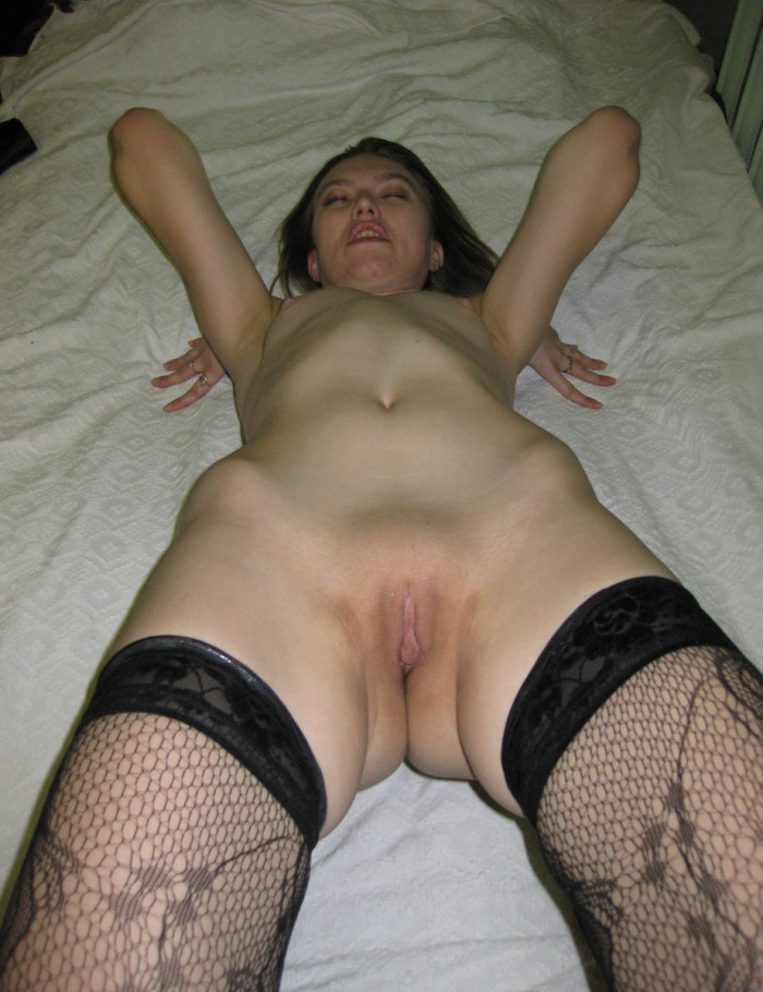 Nice milf in stockings shows shaved pussy