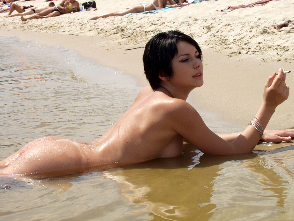 Short-Haired Brunette Is Undressing At Public Beach -1556