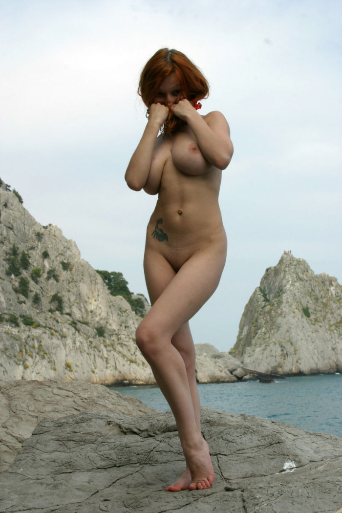 smiling redhead with huge boobs undressing russian sexy
