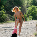 Sporty redhead walks naked at public