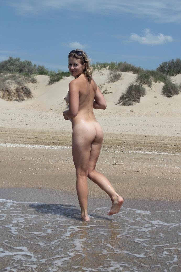 sexy blonde at beach undress