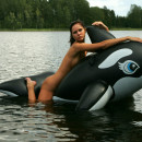 Amazing russian girl swims naked with an inflatable toy
