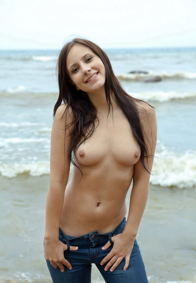 Teen topless at sea