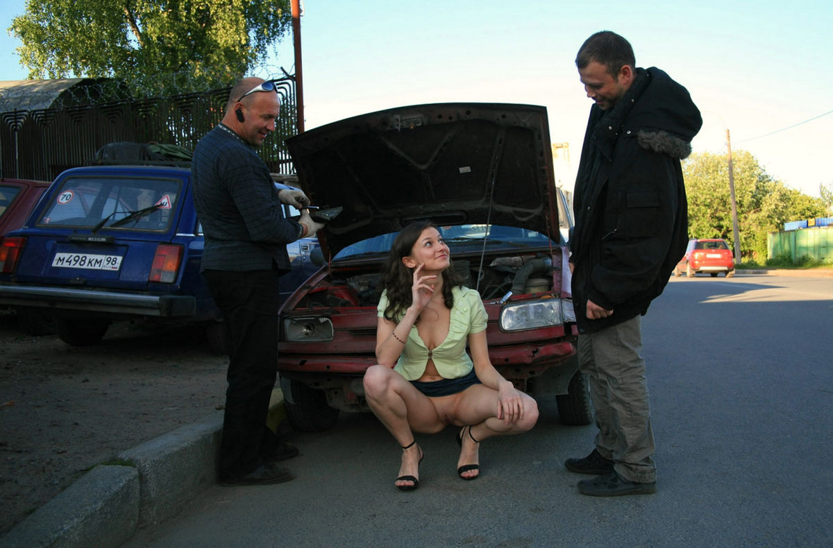 naked women fixing car