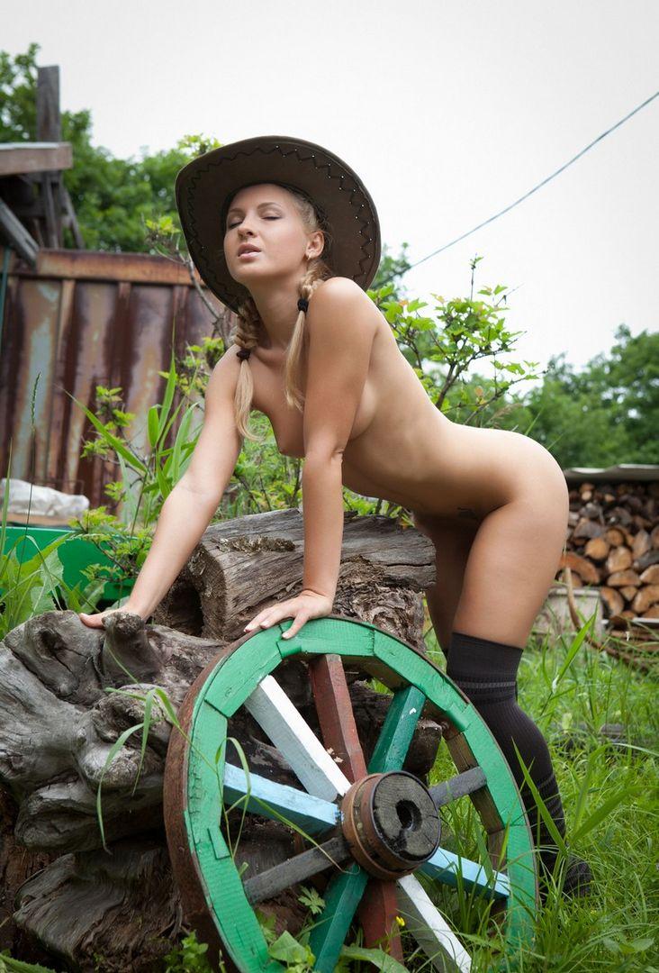 Nude girls chopping wood