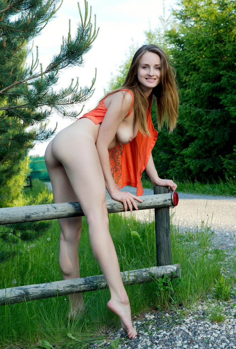 Sporty Girl With Long Legs Is Undressing Outdoors -5080