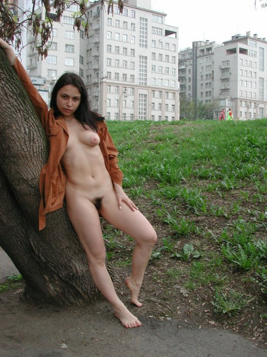 Tiny brunette shows her very hairy big pussy at public