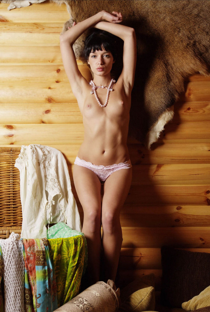 Very skinny russian babe posing at rocks