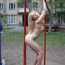 Sporty blonde who has amazing body at public yard