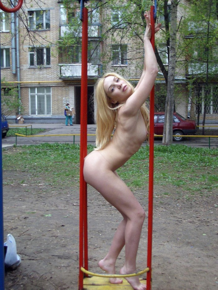 Russian blonde is undressing yellow bikini at winter forest
