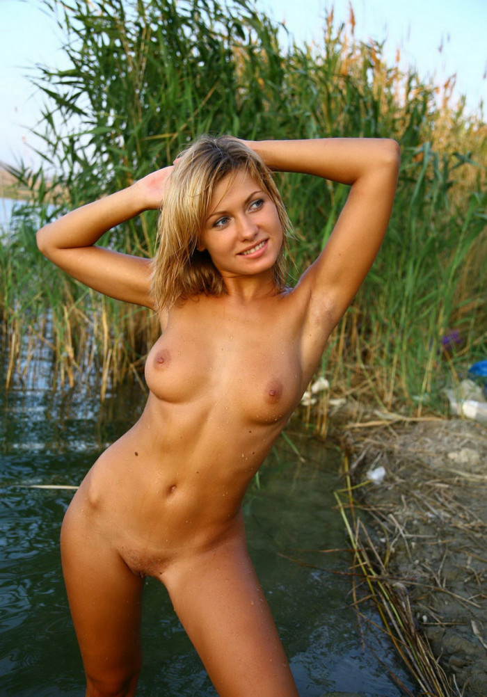 Sweet russian hottie posing naked at river