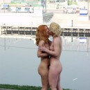 Two russian girls walking naked and kissing at public place