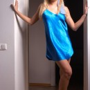 Very attractive blonde takes off her blue dress