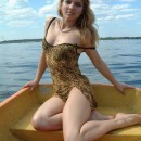Youthfull big-chested blonde posing nude at boat