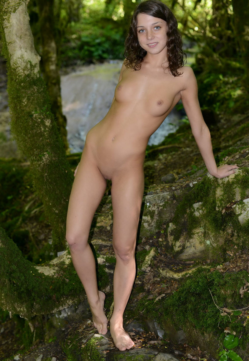 Prompt, sensual lady in woods was