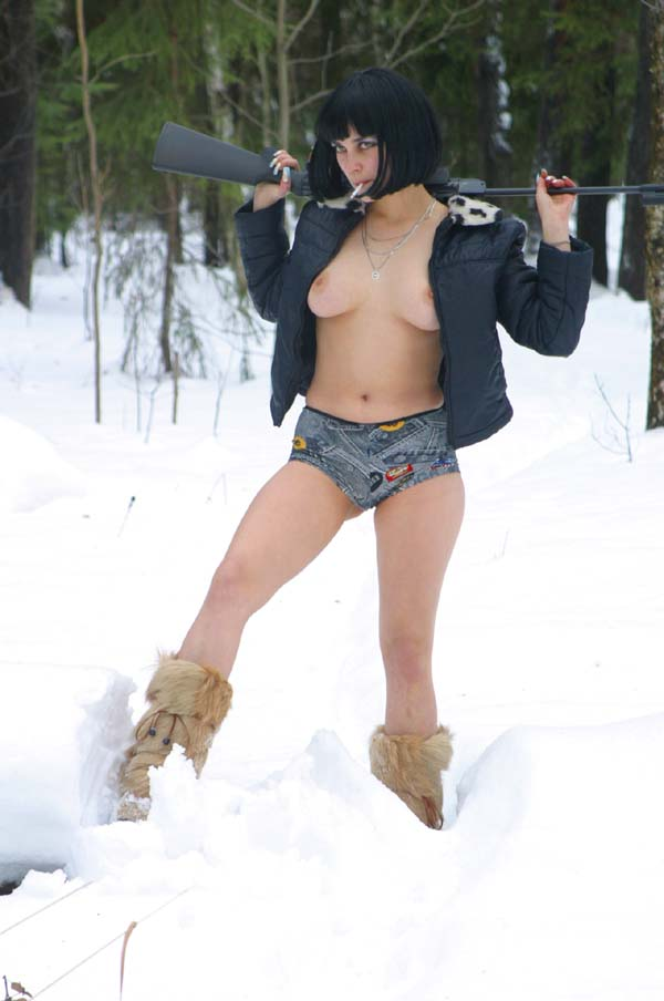 Sweet redhead takes off her dress at private cottage at winter