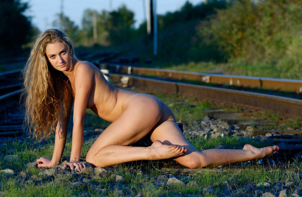 Curly russian blonde posing naked on railways | Russian ...