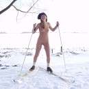 Naked blonde with a shaved pussy skiing