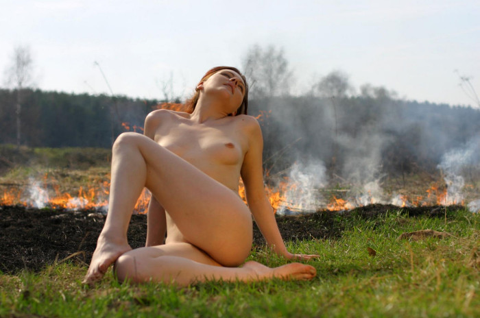 naked girl burning the grass on the nature russian sexy