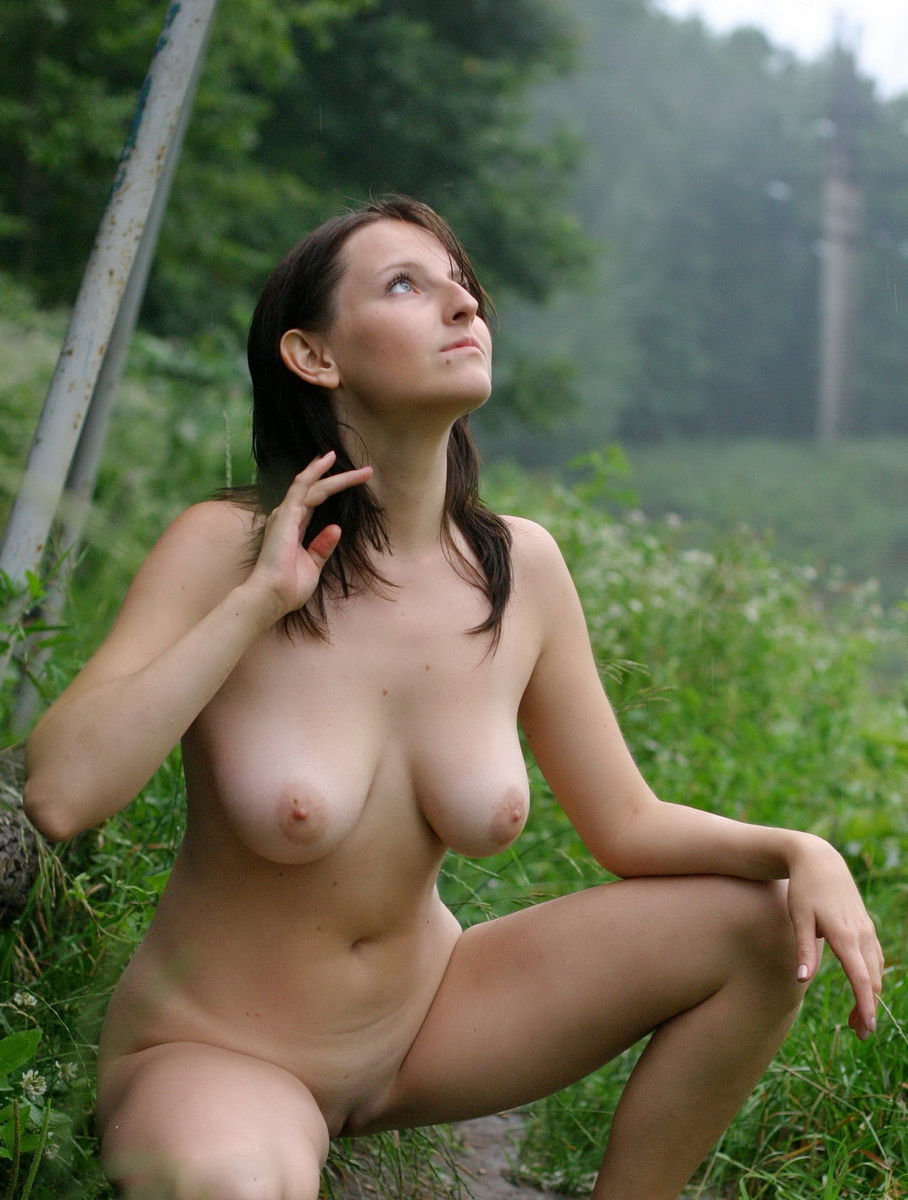 Naked girl in rain
