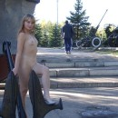 Naked girl walks through the park in the middle of the day