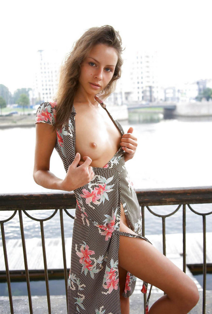 Amazing blonde shows her gorgeous boobs outdoors