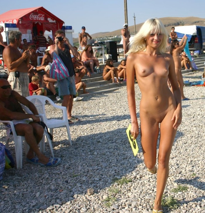 Sexy blondie walking nude at the public beach.jpg