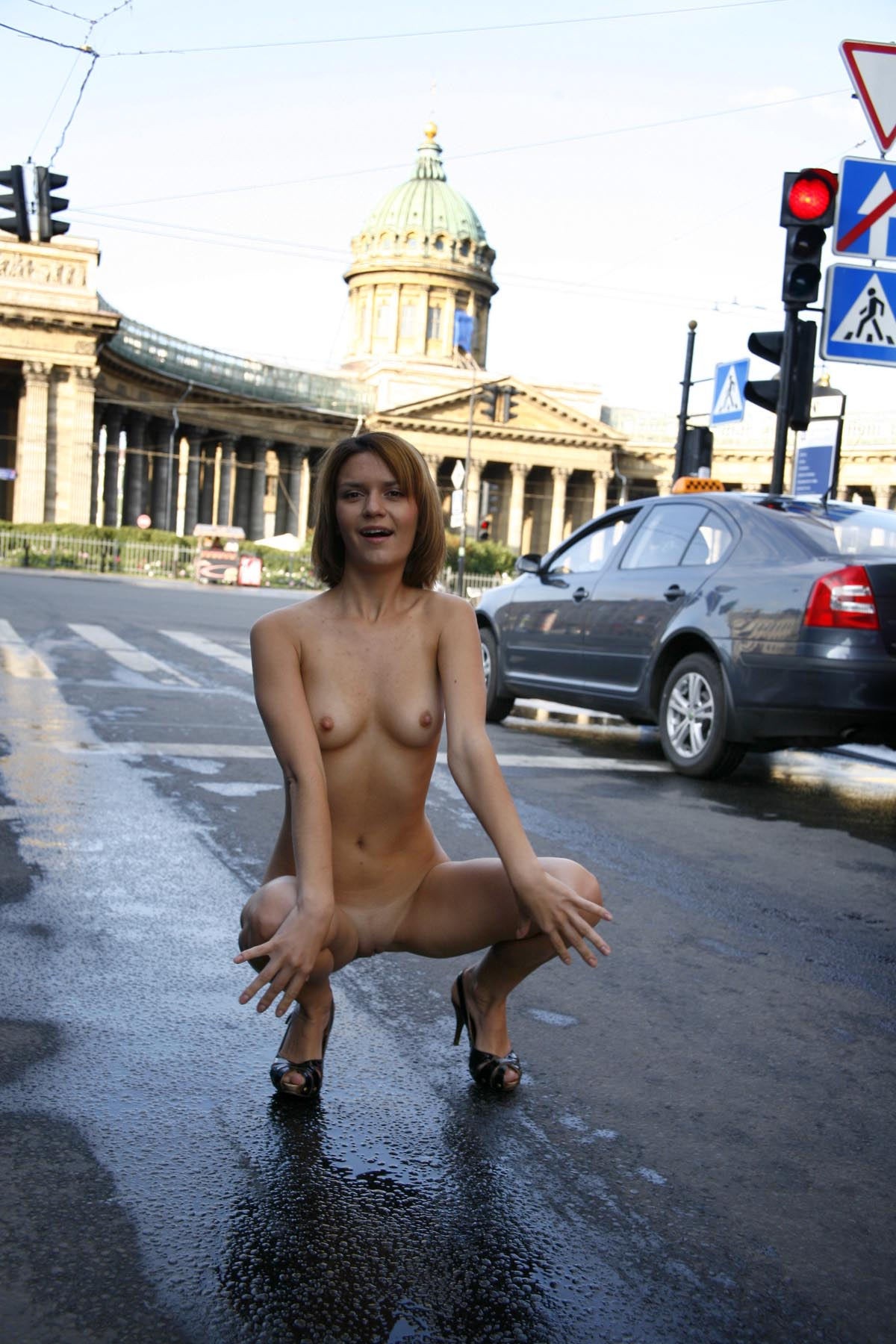 Shameless girl shows her naked body on the streets ...