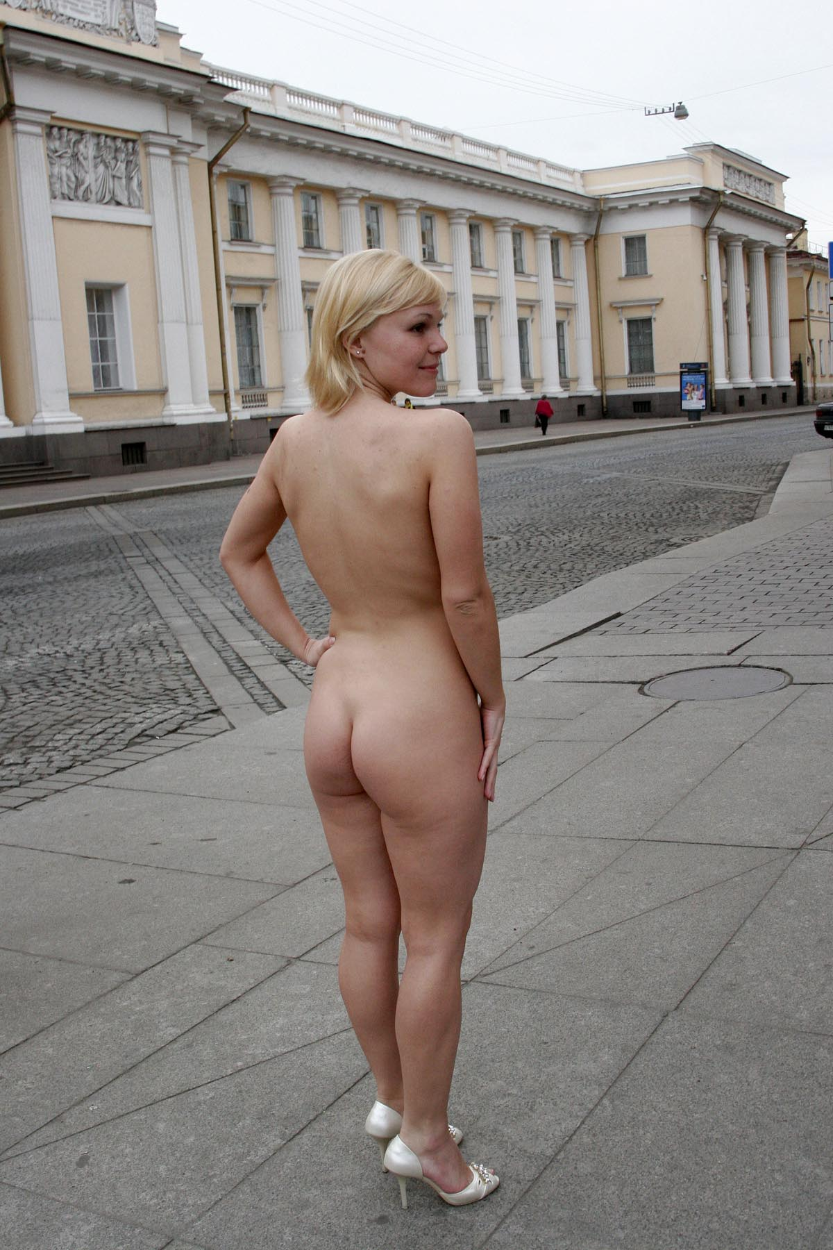 short haired blonde posing naked at city center russian