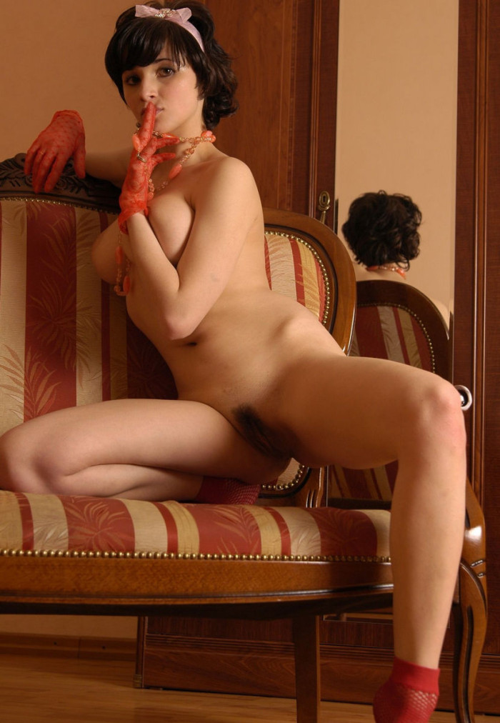Short haired brunette with big boobs and big hairy pussy posing only in red socks and red gloves