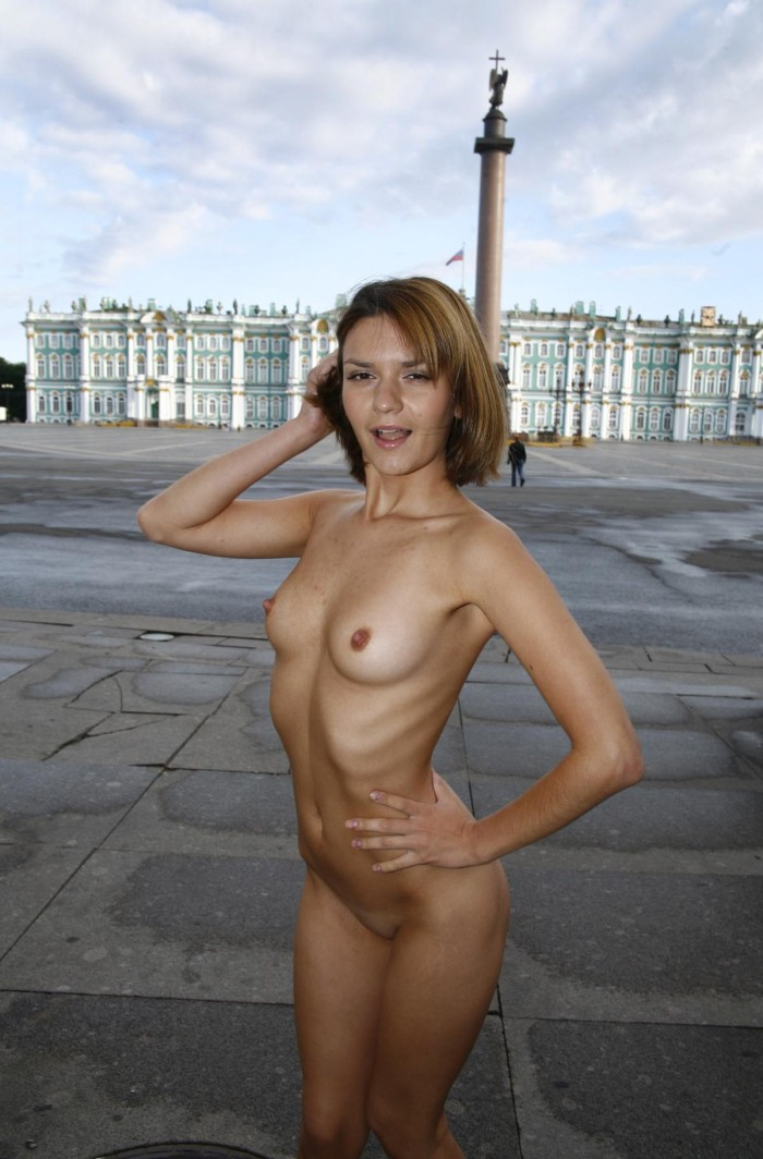 Redheaded russian chick exposes naked body in the fields