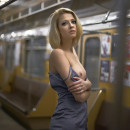 Skinny russian blonde is undressing at subway