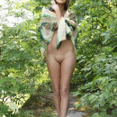 Skinny teen with small tits masturbates in the woods