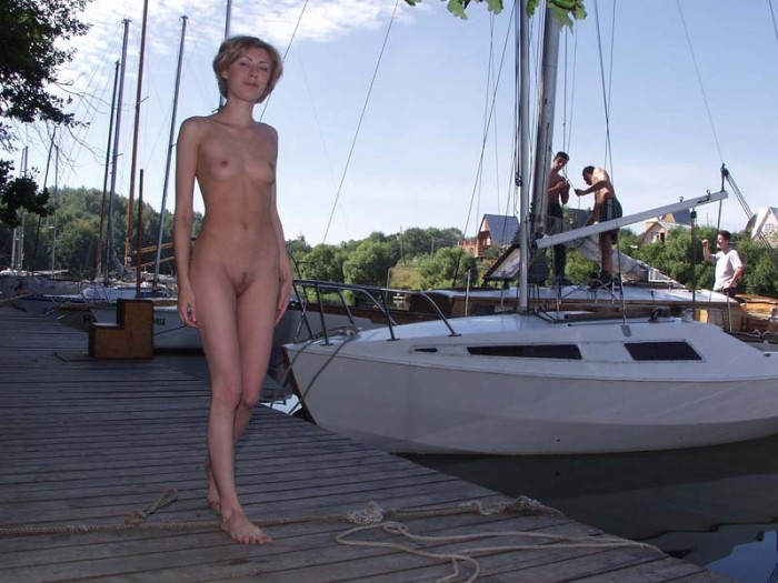 Lovely girl with small tits and hairy pussy posing at pier at winter