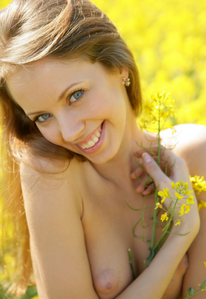 Beautiful Russian Girl Undressing In A Field With Flowers -1048