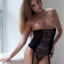 Beautiful doll in sexy dress loves to show her sweet pussy